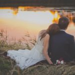 wedding-couple-sitting-on-green-grass-in-front-of-body-yourtherapist